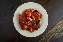 Grilled Garlic Watermelon. Grilled watermelon with fresh roasted garlic and grape tomatoes Royalty Free Stock Photo
