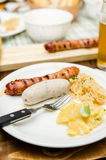 Grilled Weisswurst with sauerkraut Stock Images