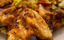 Grilled well seasoned crispy chicken wings close-up stock photo