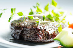 Grilled whale steak with thymus. Grilled whale steak pepper flavored with thymus Royalty Free Stock Images