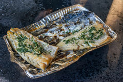 Grilled white codfish cod fish silver tray coaster single use Royalty Free Stock Image