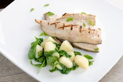 Grilled white fish fillets with potato Royalty Free Stock Images