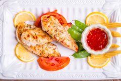 Grilled white meat chicken breast, chicken strips Stock Photography