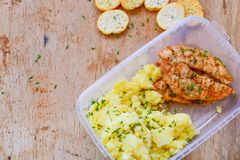 Lunch box. Grilled white meat with vegetables Home made grilled chicken fillets,potato puree and bruschetta. Healty lunch box stock photo