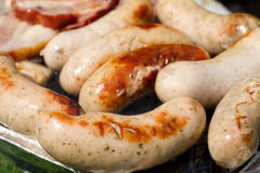 Grilled white sausages Stock Photo