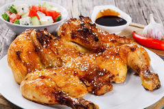Grilled whole chicken and salad in white bowl Stock Photo