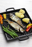 Grilled whole rainbow trout with vegetables Royalty Free Stock Images