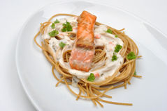 Grilled wild salmon steak with pasta Royalty Free Stock Photography