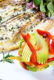 Grilled wild sea bass. Plate of high-level creative cuisine, created by international chef royalty free stock photos