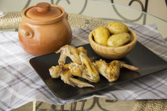 Grilled wings and potato Royalty Free Stock Photos