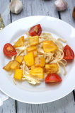 Grilled yellow peppers with tomato on pasta Stock Images