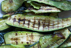 Grilled zucchini. Oiled zucchini  grilled on a barbecue Royalty Free Stock Photos