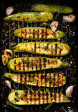 Grilled zucchini with addition of thyme, lemon zest and garlic Royalty Free Stock Photography