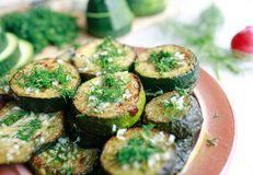 Grilled zucchini with garlic and herbs Royalty Free Stock Image