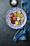 Grilled zucchini and red onion on a plate Stock Photography