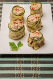 Grilled zucchini rolls with curd cheese and tuna on plate. Royalty Free Stock Photo