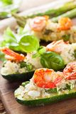 Grilled zucchini stuffed with shrimps  and cauliflower rice Stock Photos