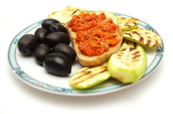 Grilled zucchini, toast bread and olives Royalty Free Stock Images
