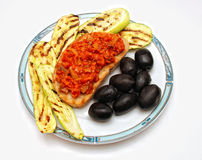 Grilled zucchini, toast bread and olives royalty free stock photos