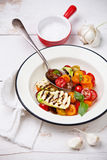 Grilled zucchini with tomato stock photo