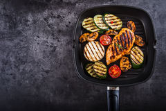 Grilled Zucchini Tomato with chili pepper.  Italian mediterranean or greek cuisine. Vegan vegetarian  food Stock Photos