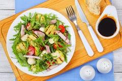 Grilled zucchini, tomato greens summer salad Stock Photo