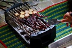 Griller les piments et le galanga secs Photo libre de droits