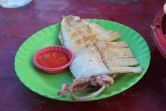 Grillfesttioarmad bläckfisk Royaltyfri Fotografi