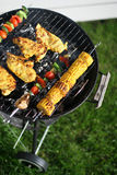 Grilling. Meat and vegetables on a grill Royalty Free Stock Photography