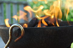 Grilling. Flames leaping into the air from charcoal briquettes Royalty Free Stock Images