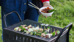 Grilling Barbie Q. Grilling Barbecue in a good day Royalty Free Stock Photography