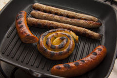 Grilling bavarian sausages Stock Images