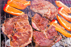 Grilling beef steaks Stock Photos