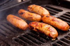 Grilling Brats Stock Photo