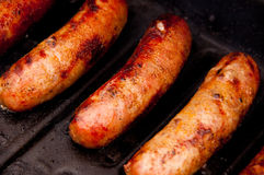 Grilling Brats Royalty Free Stock Images