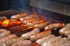 Grilling brats Stock Images