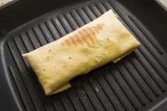 Grilling burrito Stock Photos