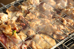Grilling chicken on barbecue grill. Royalty Free Stock Image