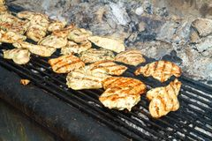 Grilling chicken breast on a coal grill Royalty Free Stock Photo