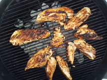 Grilling chicken breast. Chicken breast on the grill Stock Photography