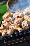 Grilling chicken in grid Stock Photography
