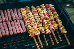Grilling chicken meat skewers and kebab with vegetables on barbecue charcoal grill Royalty Free Stock Photography