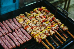Grilling chicken meat skewers and kebab with vegetables on barbecue charcoal grill.  stock image