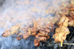 Grilling chicken with smoked Stock Photography
