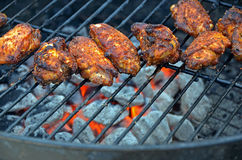 Grilling chicken wings Royalty Free Stock Images