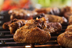 Grilling chicken wings on barbecue grill Stock Photo