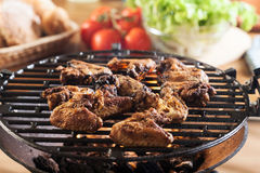 Grilling chicken wings on barbecue grill Stock Photography