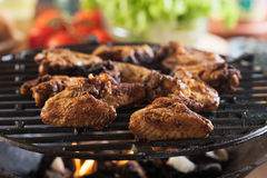 Grilling chicken wings on barbecue grill Royalty Free Stock Images