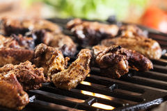 Grilling chicken wings on barbecue grill Royalty Free Stock Image