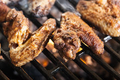 Grilling chicken wings on barbecue grill Royalty Free Stock Photography